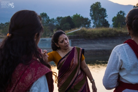 Ramaa explaining a gesture - evening class by the lake